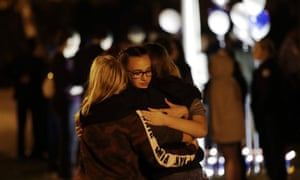 Students embrace during a vigil in the aftermath of the shooting at Saugus high school.