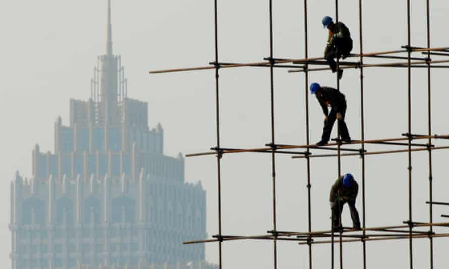 Builders in Shenyang, China: party control will not permit a full ascent to prosperity.