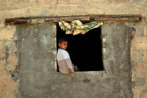 A Yemeni child stands inside his house which was damaged in an air-strike in the capital Sanaa.
