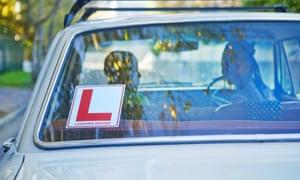 A learner sticker on the back windscreen of a car