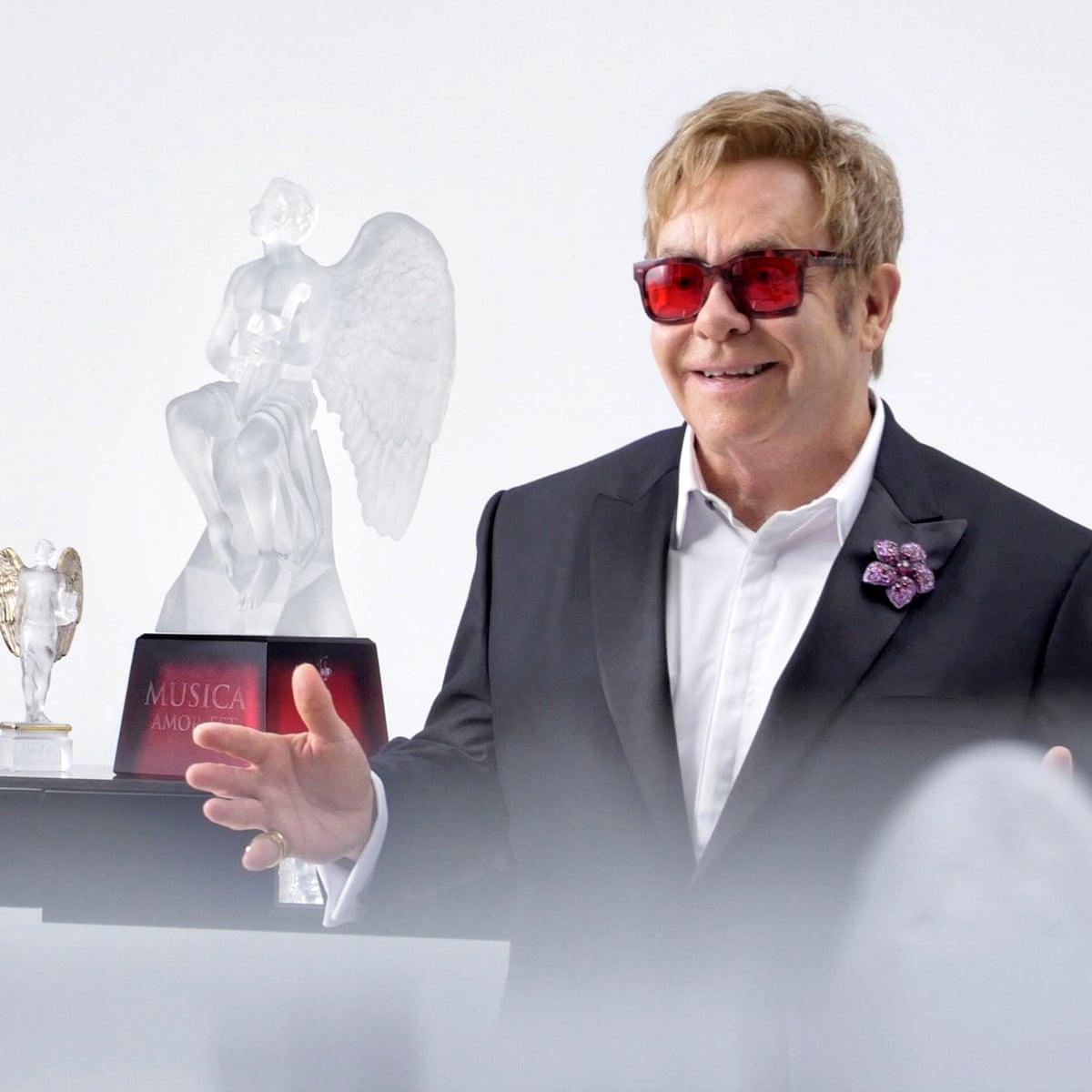 Elton John Unveils Angel Crystal Sculpture For Aids Foundation Elton John The Guardian