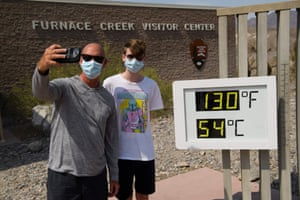Texas, US: Tourists take pictures with a thermometer showing the extreme heat in Death Valley.
