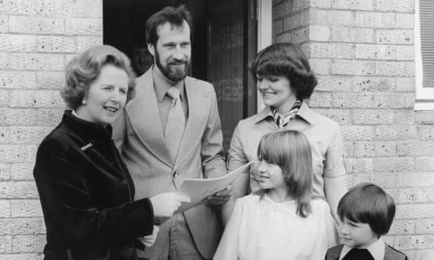 Margaret Thatcher hands property deeds to the King family – one of the first households in Britain to buy their council home in 1979.