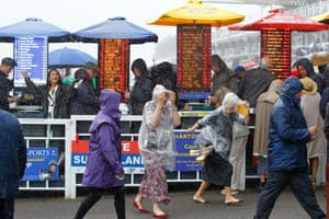Racegoers braving the wind and rain on the first day