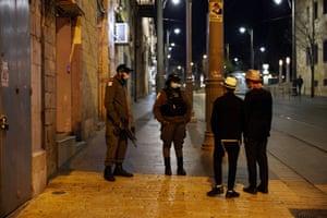 Police enforce a night curfew in Jerusalem