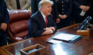 Donald J Trump signs veto of legislation to strike down his national emergency declaration at the southern border on Friday.