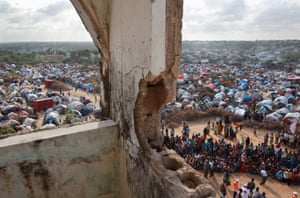 Mogadishu, 2011 People wait for cooked food at a feeding centre at a camp for Somalis