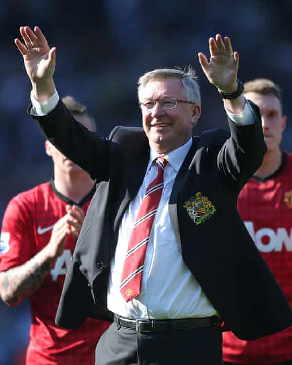 Alex Ferguson salutes supporters after leading Manchester United to a 13th Premier League title under him.