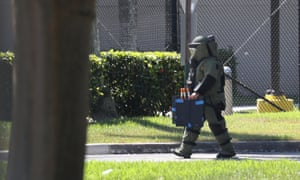 A member of the Broward sheriff's office bomb squad investigates a suspicious package in the building where congresswoman Debbie Wasserman Schultz has an office in Sunrise, Florida.