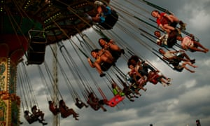 People enjoy a ride at an amusement park in New Jersey, during Memorial Day weekend