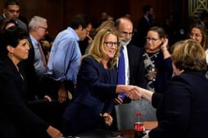 Ford shakes hands with Phoenix prosecutor Rachel Mitchell after she finished testifying