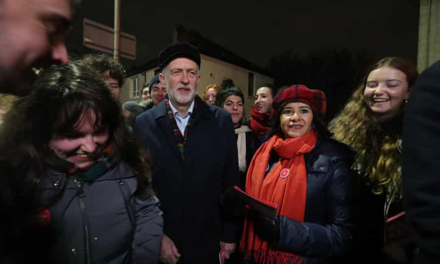 Labour party leader Jeremy Corbyn and his wife Laura Alvarez with Labour activists while canvassing in Govan, Glasgow.