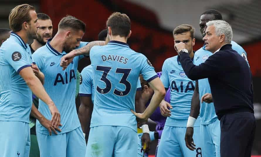 Jose Mourinho (right) talks to his players in a drinks break during Tottenham's 0-0 draw at Bournemouth.