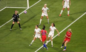 Christen Press (23) rises above England's Lucy Bronze to open the scoring for the USA.