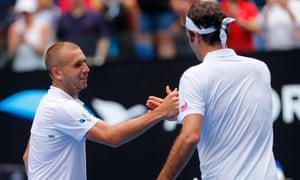 Dan Evans shakes hands with Roger Federer