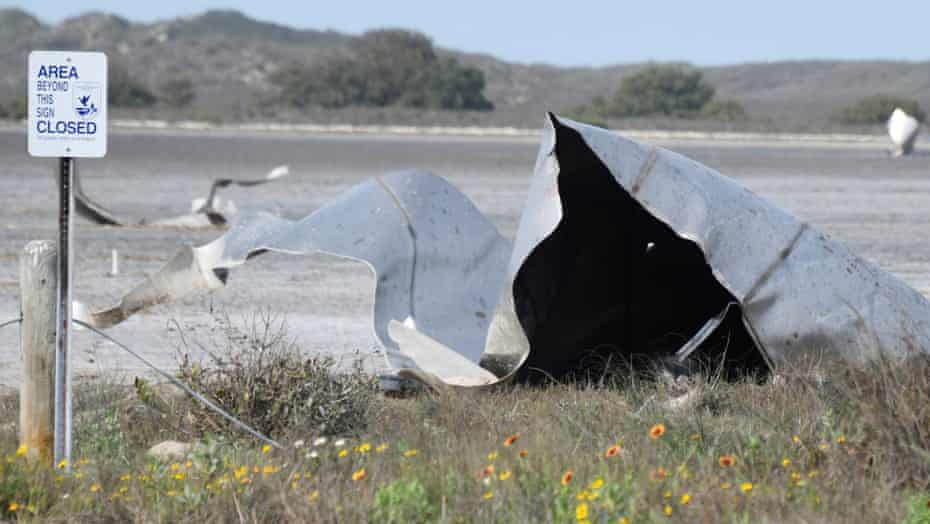 Debris is seen in the Boca Chica national wildlife refuge after the SpaceX Starship prototype rocket failed to land safely on 31 March.