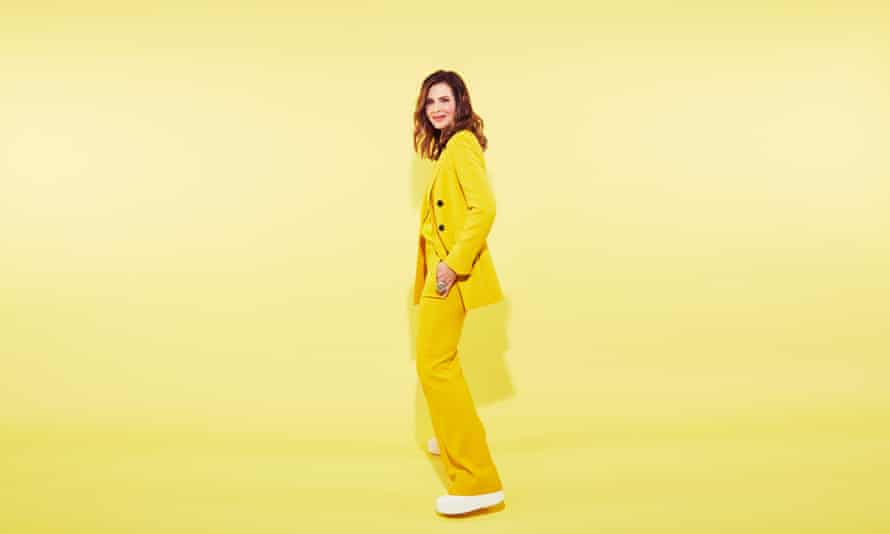 Trinny Woodall in her favourite yellow trouser suit and white trainers.