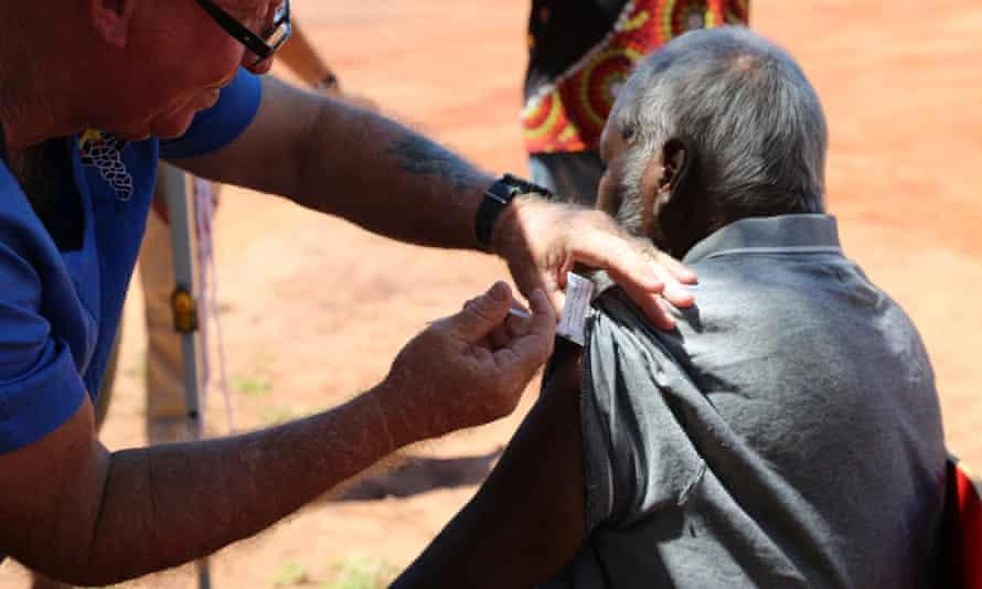 A Beagle Bay community member receives a coronavirus vaccine in the Kimberley region of Western Australia