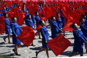 Dancers with colourful scarves take part in North Korea's 70th anniversary parade