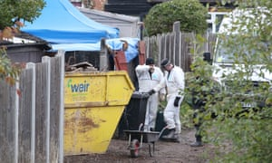 A police forensics team at the house in Sutton Coldfield, Birmingham