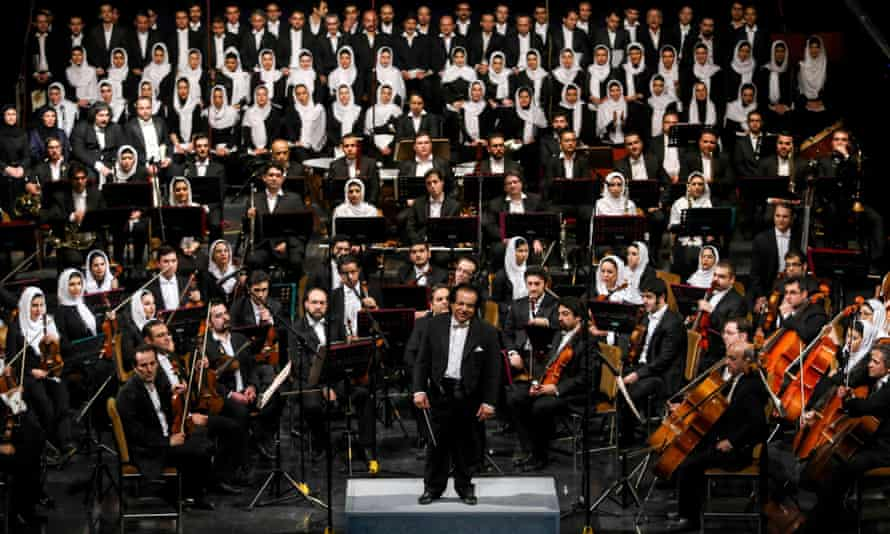 Iranian conductor Ali Rahbari and the Tehran Symphony Orchestra are greeted by the audience after performing at the Vahdat Hall in Tehran in March.