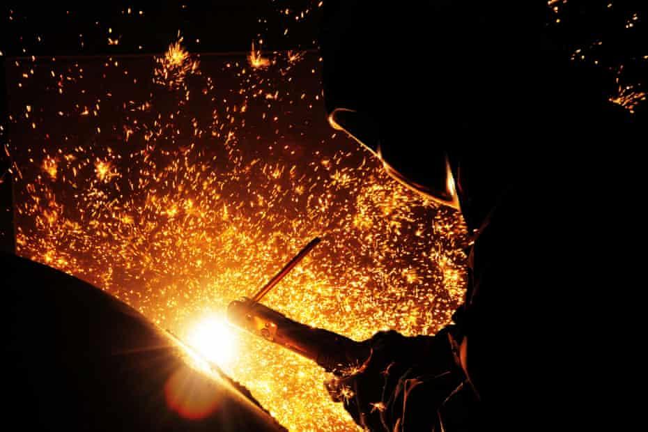 A worker welds steel