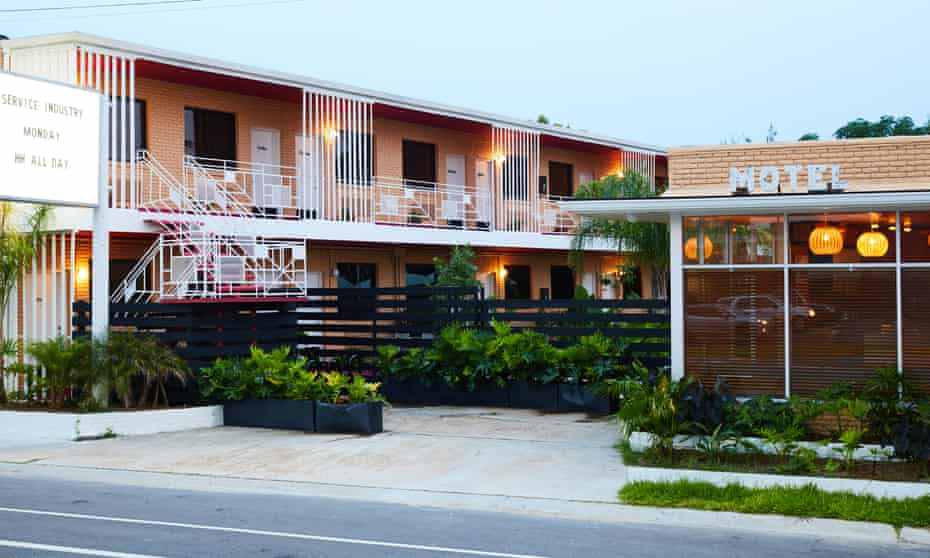 Exterior, at dusk, of THE DRIFTER, a motel in New Orleans, Louisiana.