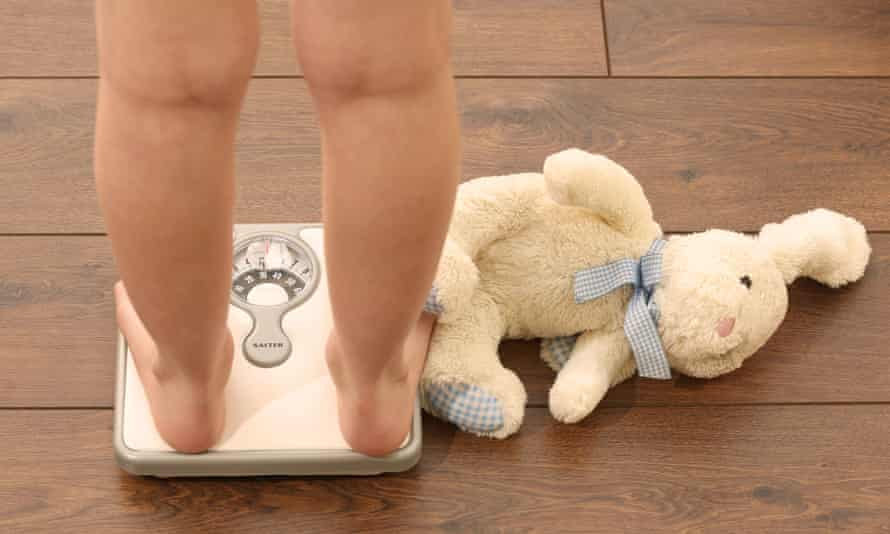 A child on bathroom scales