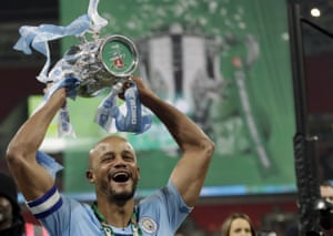 24 February 2019: Kompany lifts the trophy after winning the League Cup final after a penalty shootout victory over Chelsea.