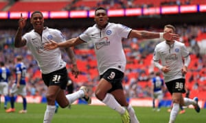 Peterborough United's Britt Assombalonga celebrates scoring their third goal from the penalty spot during the Johnstone's Paint Trophy Final at Wembley, 30 March 2014