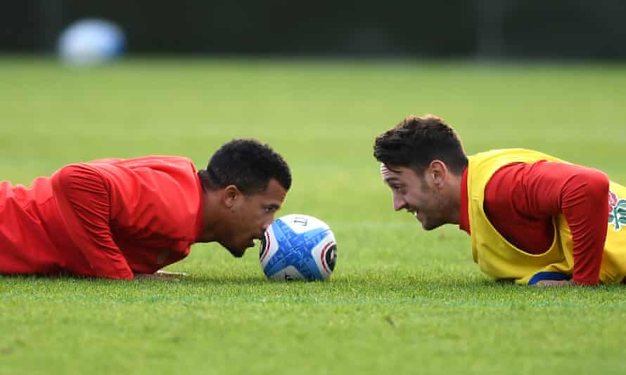 England's Anthony Watson (left) and Alex Mitchell in training. Eddie Jones's side missed out on a warm-up match after Barbarians players broke Covid protocols.