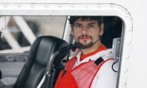 Nathan Carman arrives in a small boat at the US Coast Guard station in Boston on Tuesday.