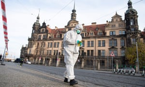 A forensic expert searches the area in front of the Royal Palace in Dresden