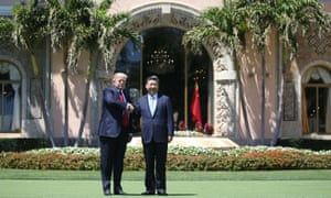 Donald Trump shakes hands with Xi Jinping at Mar-a-Lago in south Florida.