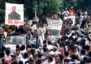 People in Timor-Leste display anti-Indonesia banners as they take to the streets in 1998
