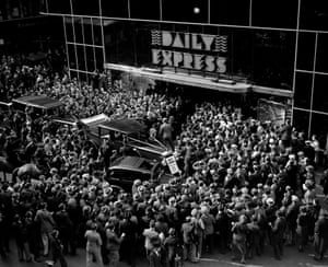 Crowds outside the Daily Express building in December 1932, waiting to greet English aviator Amy Johnson after her record solo flight to Cape Town