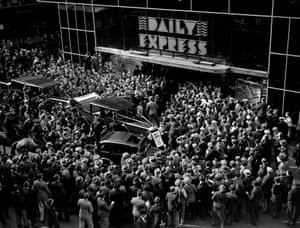 Crowds gather at the entrance to the Daily Express building, Fleet Street, London, to greet English aviator Amy Johnson in December 1932.