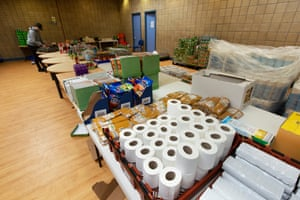 Assembling the food parcels. They contain enough for breakfast, lunch and dinner for a family of four for a few days, plus biscuits, milk, bread, jam, detergent, toiletries and sanitary products.