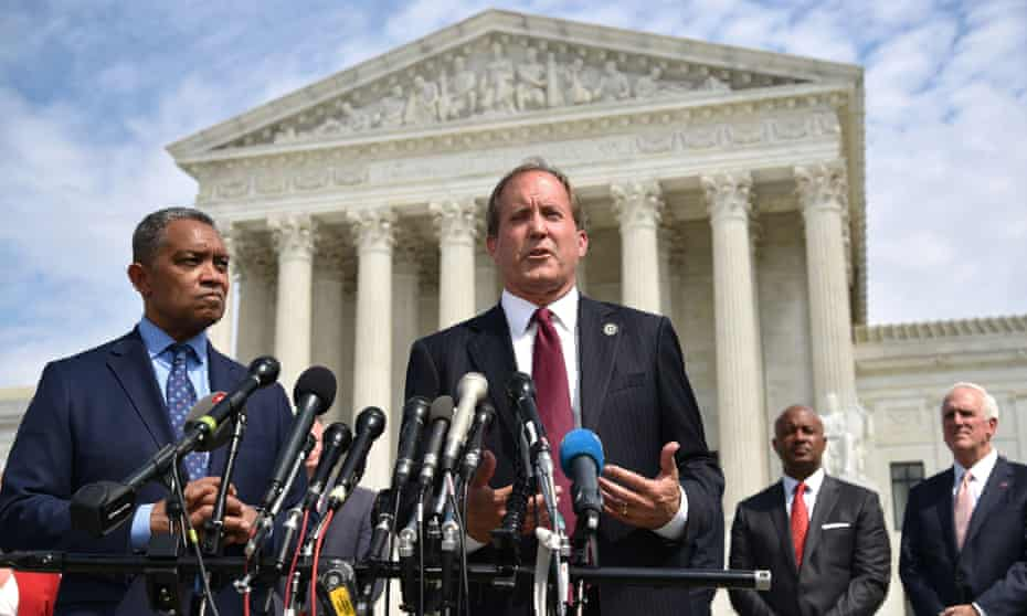 Karl Racine, the attorney general for Washington DC, and Texas attorney general, Ken Paxton, speak outside of the US supreme court in Washington, DC on 9 September 2019.