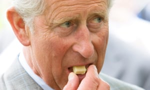 Prince Charles eats a piece of cheese during a visit to a dairy. The Prince has said he fears for the very existence of French cheese in a world of genetically modified produce.