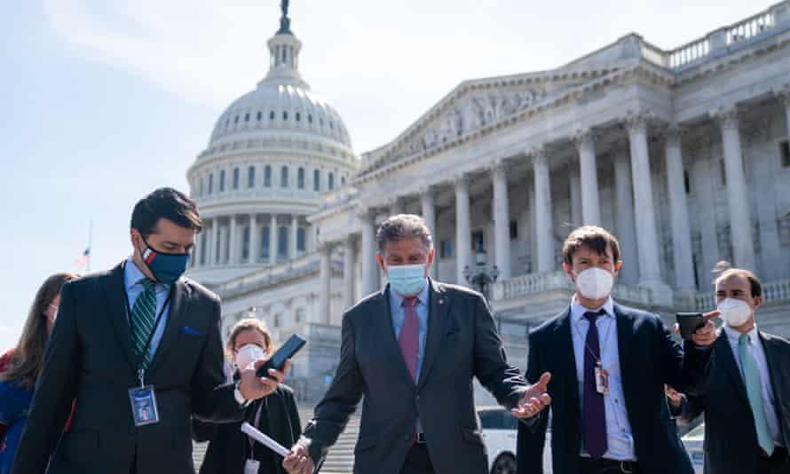 Senator Joe Manchin speaks with reporters on Capitol Hill on 13 April.