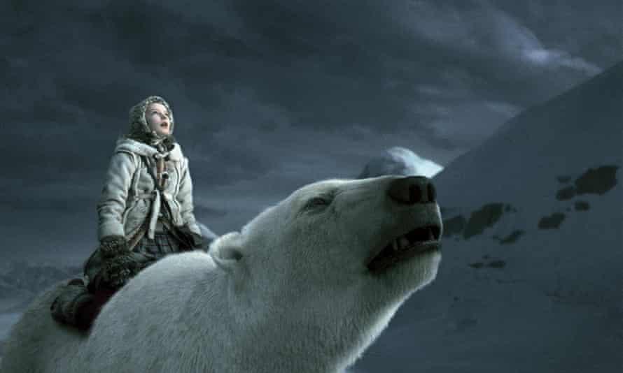 Dakota Blue Richards atop a polar bear in a still from the film His Dark Materials: The Golden Compass.