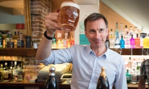 Jeremy Hunt holding up a pint of beer