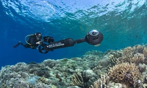 A scientist conducts a reef survey using a scooter with a 360 degree camera set up in Manado, Indonesia.