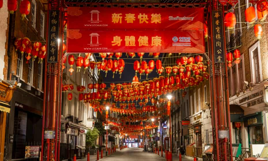 Red alert: a deserted Gerrard Street in Chinatown in London on 27 March 2020.