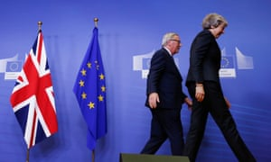 Theresa May and Jean-Claude Juncker leave the EU's headquarters in Brussels, Belgium.