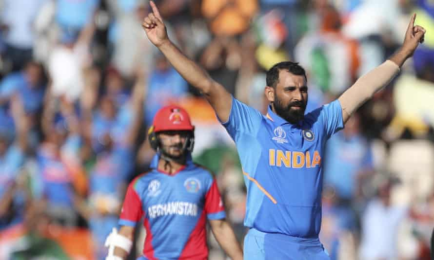 India's Mohammed Shami, right, celebrates after dismissing Afghanistan's Mohammad Nabi