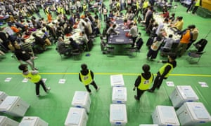 Election officials count ballots at a polling station during the general election in South Korea