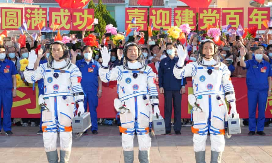 Astronauts Nie Haisheng (R), Liu Boming (C) and Tang Hongbo wave during a see-off ceremony for Chinese astronauts of the Shenzhou-12 manned space mission at the Jiuquan Satellite Launch Center in northwest China, June 17, 2021. China Shenzhou 12 Astronauts See Off Ceremony - 17 Jun 2021