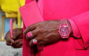 Nairobi, Kenya: Fashionista James Maina Mwangi poses for a photograph wearing matching accessories